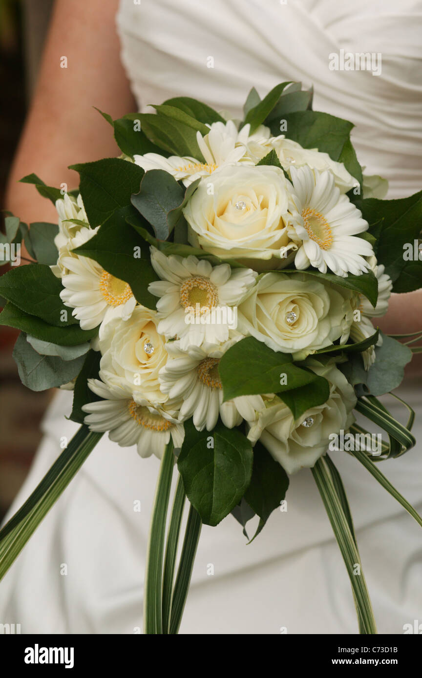 A Wedding Flowers Bouquet Of Cream Roses And Gerberas With Green