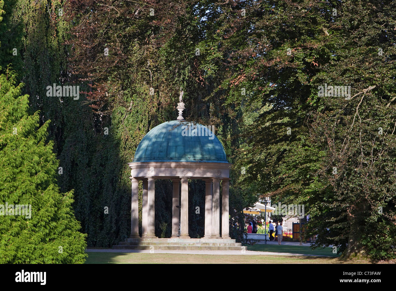 Beech trees surrounding the pavilion temple in Bad Pyrmont Spa Gardens Bad Pyrmont Weserbergland Lower Saxony Northern - Stock Image