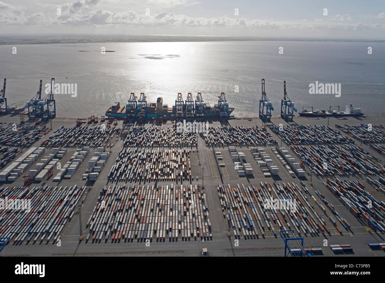 Aerial view of the container port, Containers and loading cranes in the backlight, Bremerhaven, northern Germany - Stock Image
