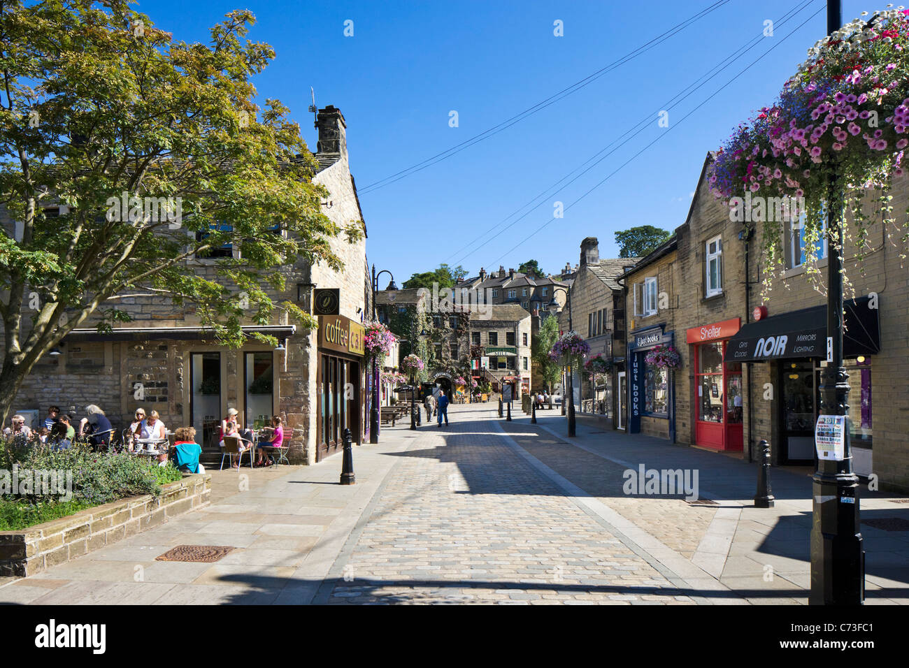 Shops and cafe on Bridge Gate in the town centre, Hebden Bridge, Calder Valley, West Yorkshire, England, UK - Stock Image