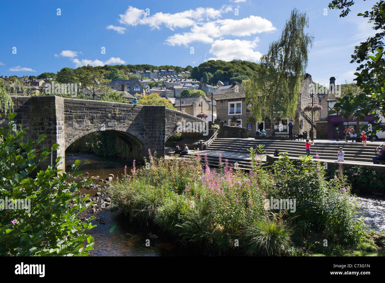 Bridge over a stream in the town centre, Hebden Bridge, Calder Valley, West Yorkshire, England, United Kingdom - Stock Image