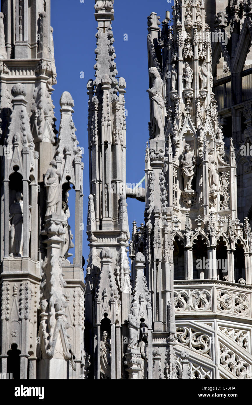 Some of the towers of Milan Cathedral (Duomo di Milano) with statues and decorations - Stock Image