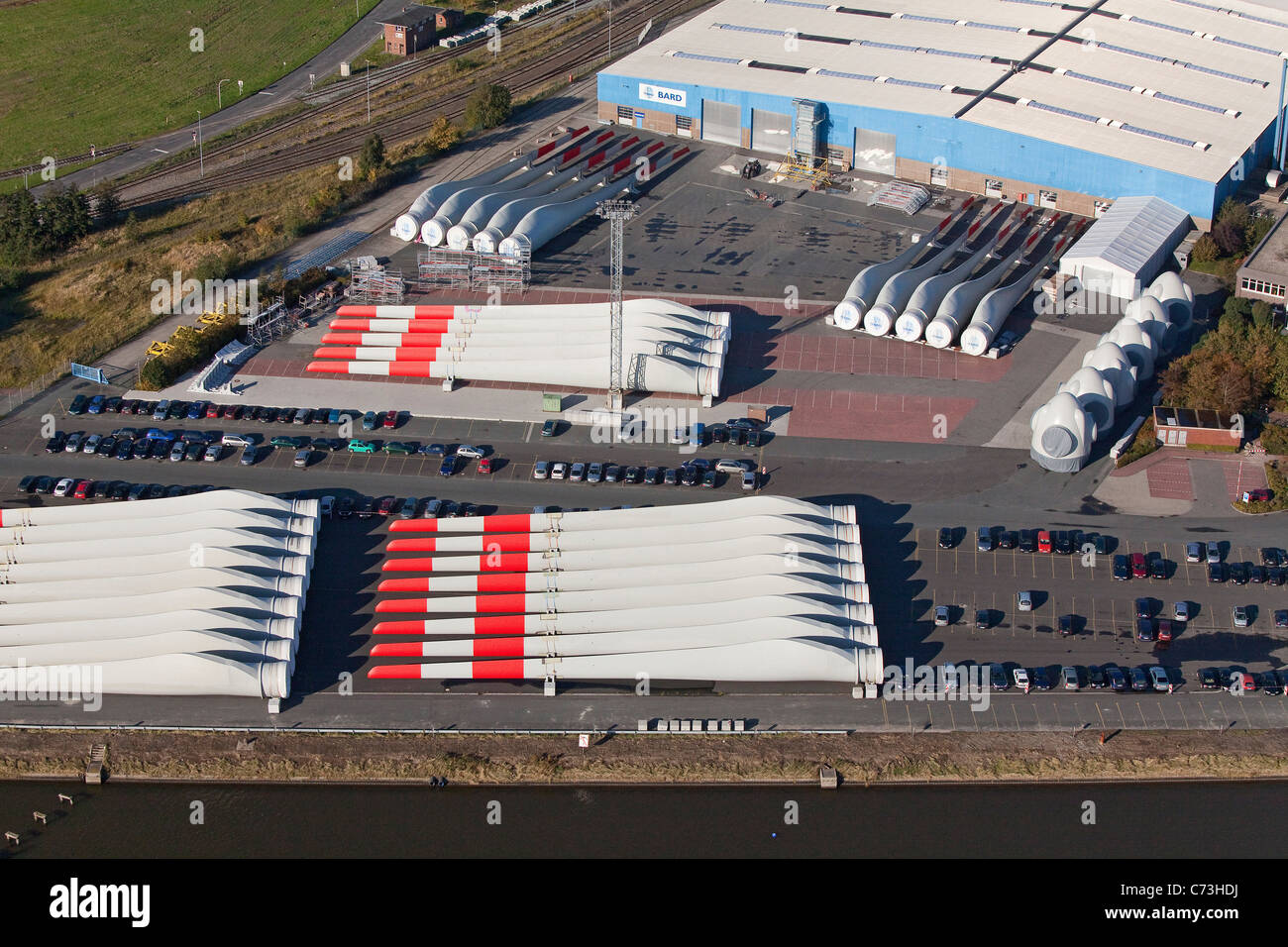 Aerial photo of rotor blades stored at a wind energy production company storage of windturbines Emden Lower Saxony - Stock Image