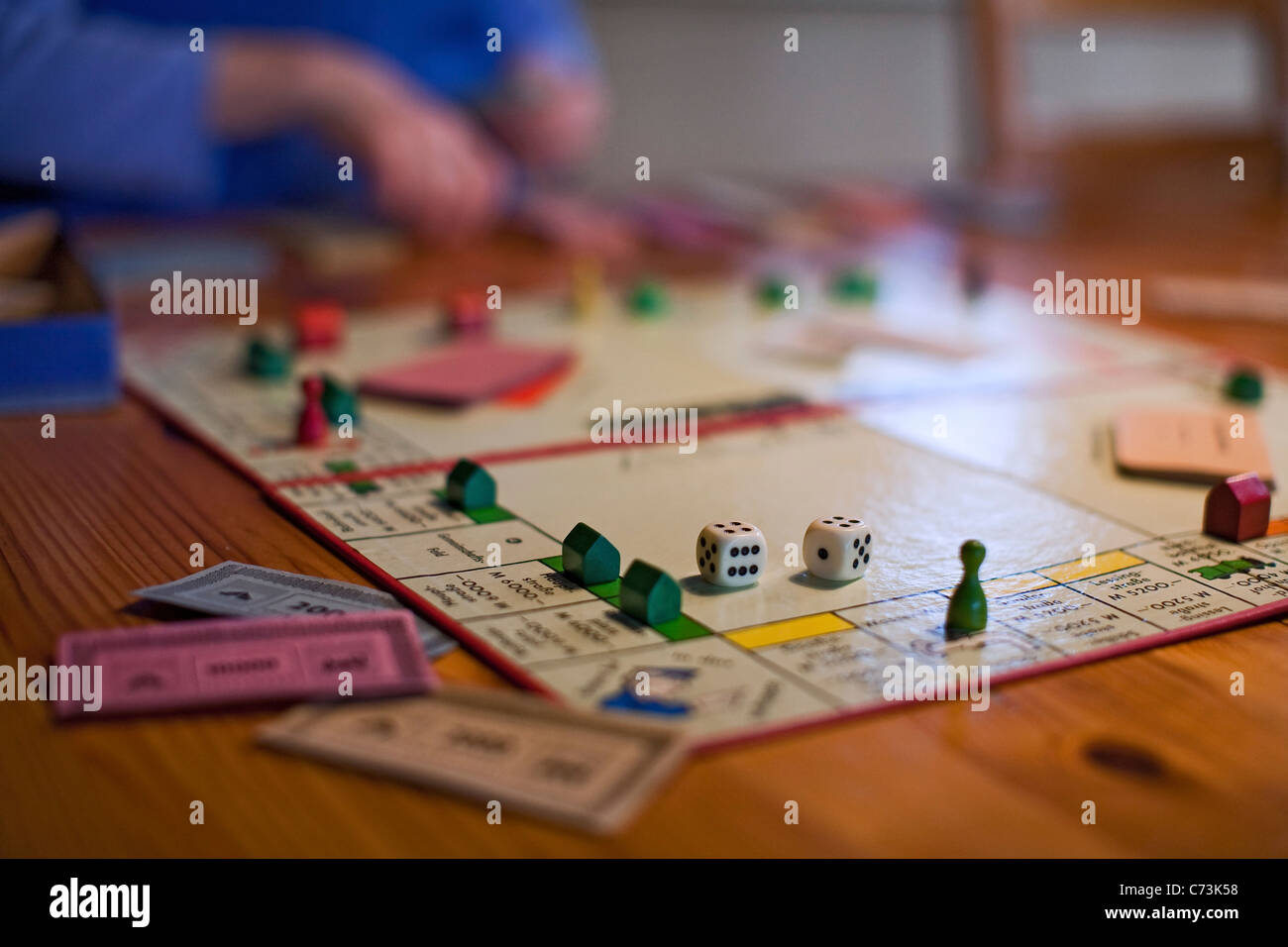 Monopoly board game, German version, detail, blurred, play money, Germany - Stock Image