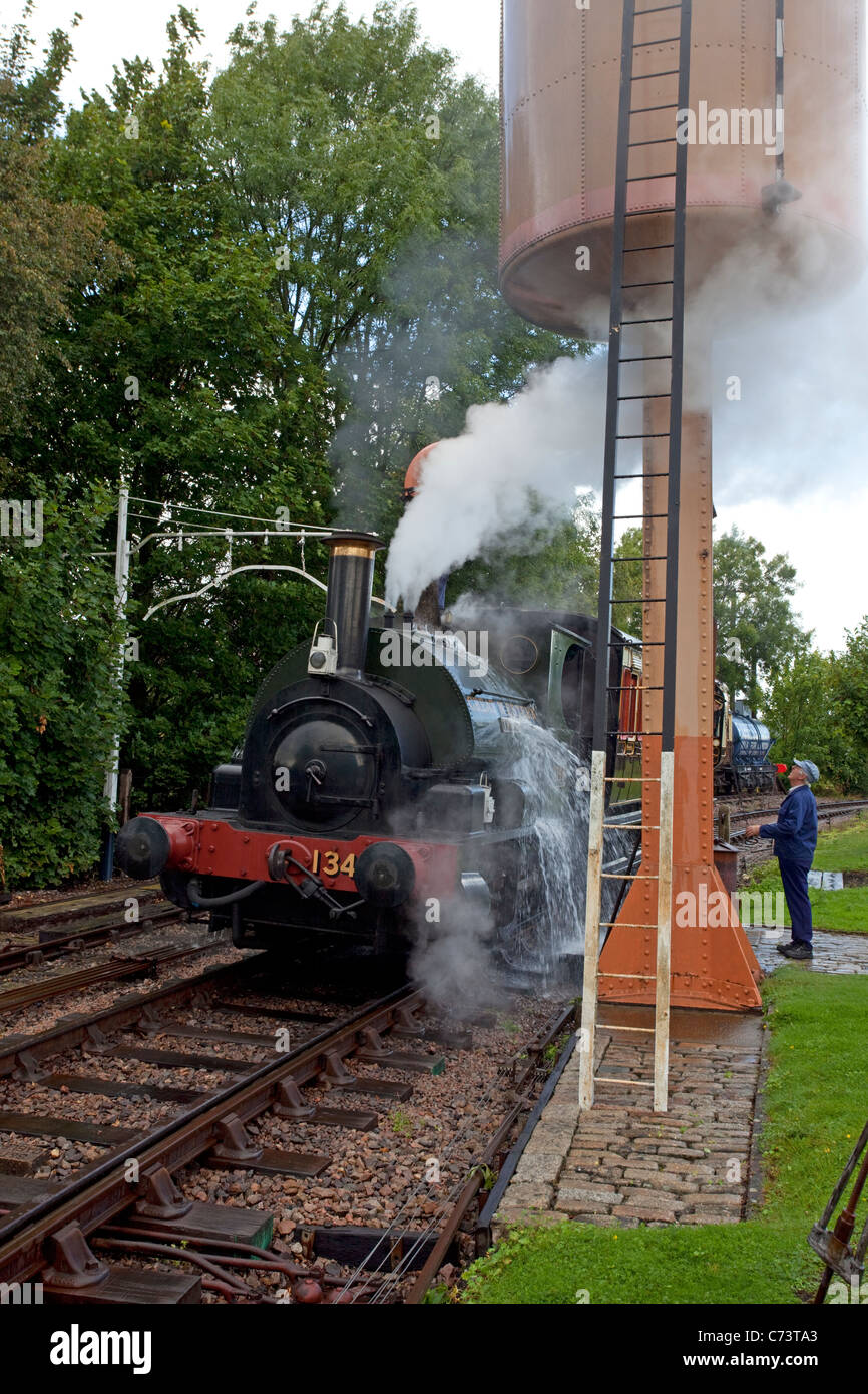 steam engine number 1340 trojan filling up with water Stock Photo