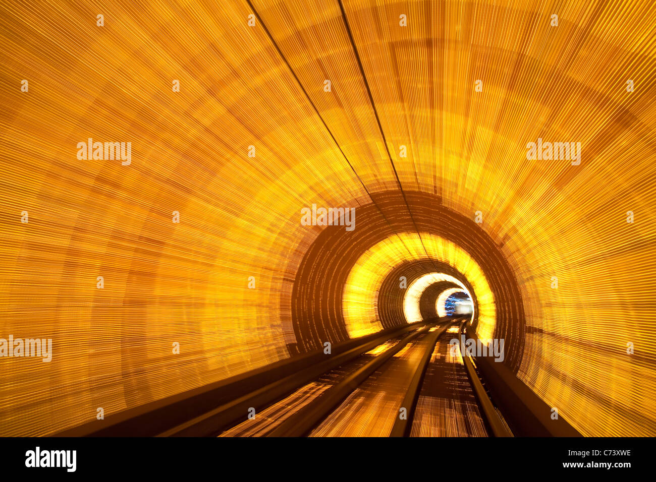 Blurred motion light trails in an train tunnel under the Huangpu tiver linking the Bund to Pudong, Shanghai, China Stock Photo