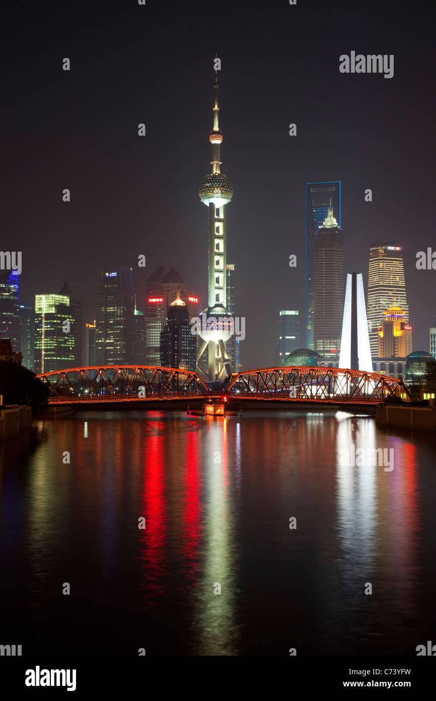 New Pudong skyline Waibaidu (Garden) Bridge looking across the Huangpu River from the Bund Shanghai China Stock Photo