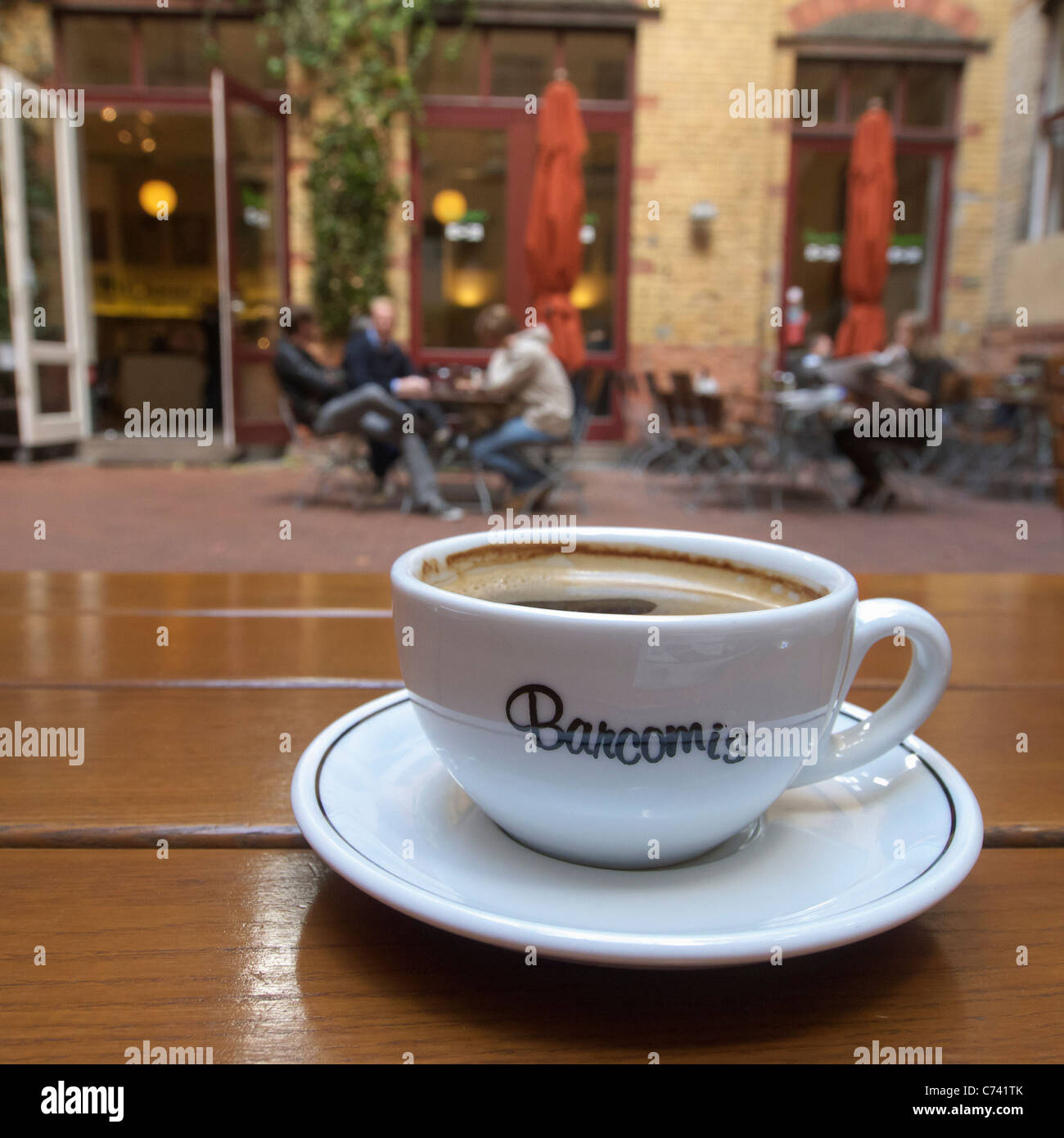 cup of coffee at Barcomis cafe in Sophie-Gips courtyard in Mitte district of Berlin in Germany - Stock Image