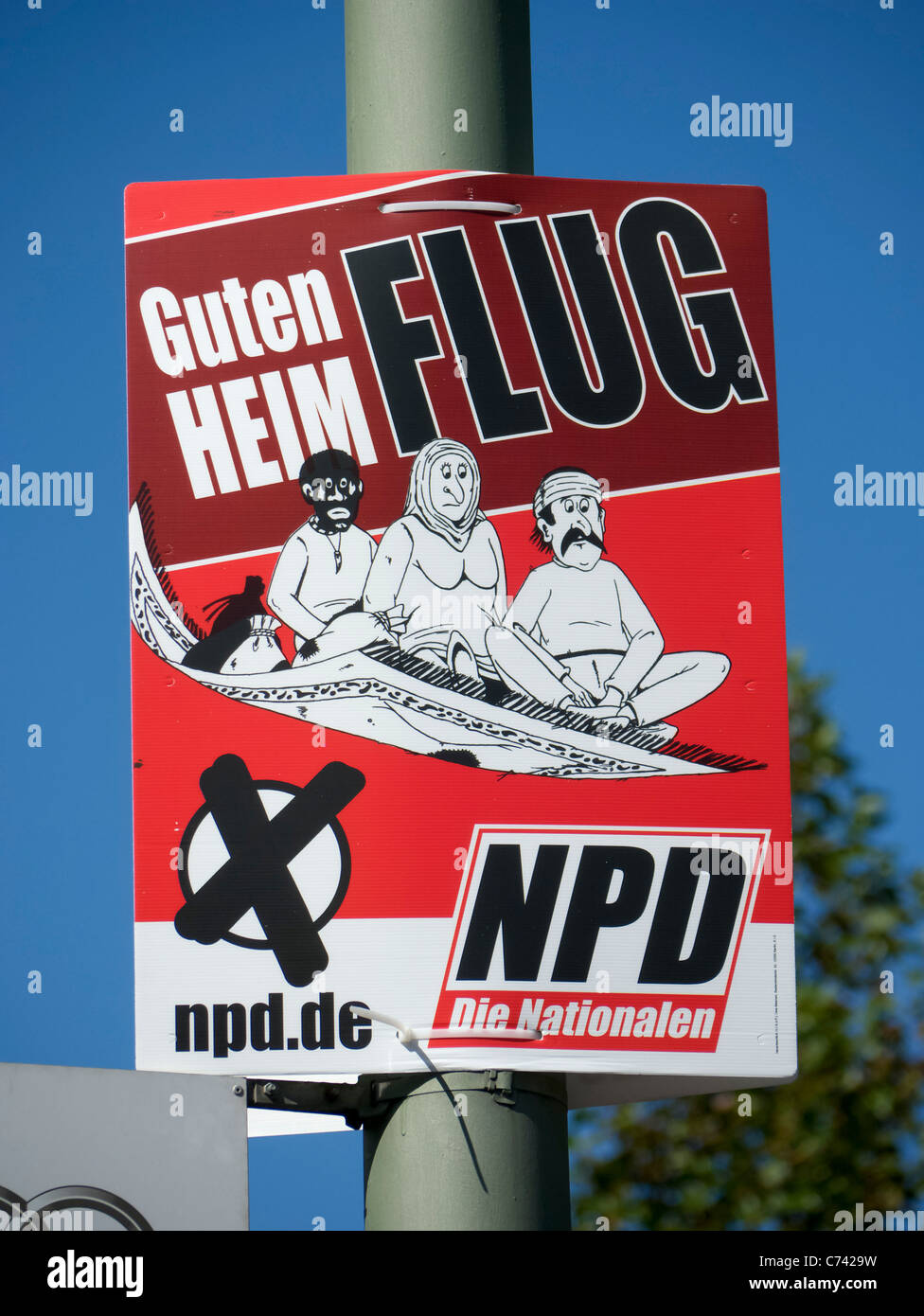 Racist party political election poster by the NPD or National Democratic Party of Germany in Berlin  before elections - Stock Image