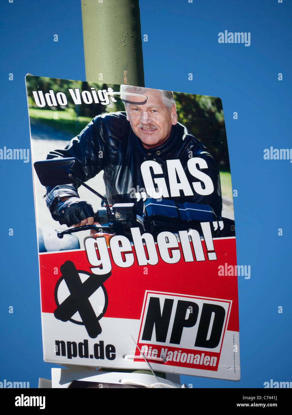 Controversial party political election poster by NPD or National Democratic Party of Germany in Berlin before election - Stock Image