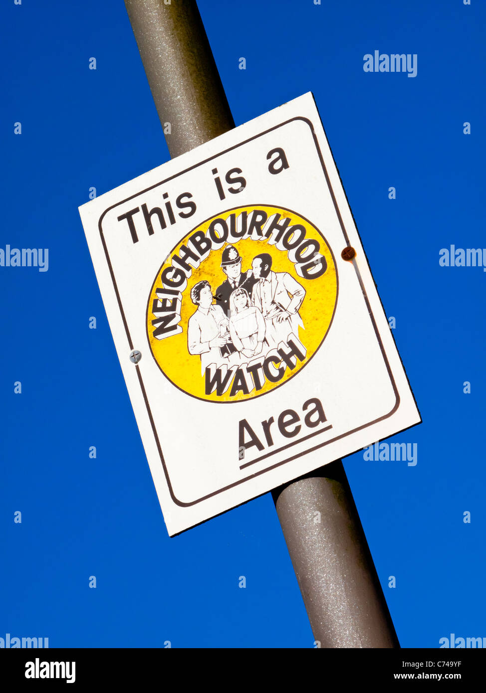Neighbourhood Watch Area sign in a UK village designed to prevent petty crime - Stock Image