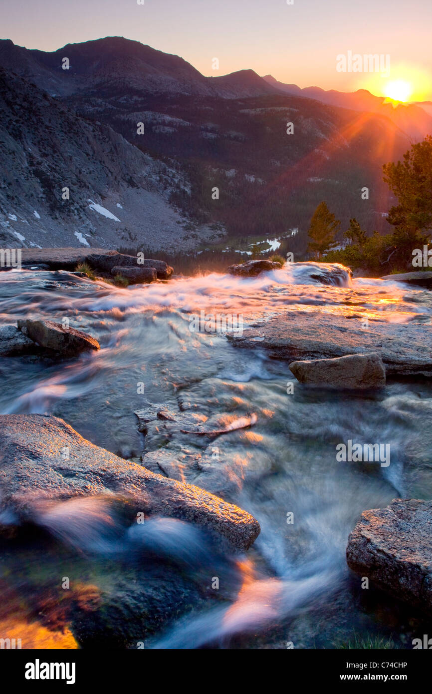 Sunset reflection on Evolution Creek in the Sierra Nevada Mountains in California. - Stock Image
