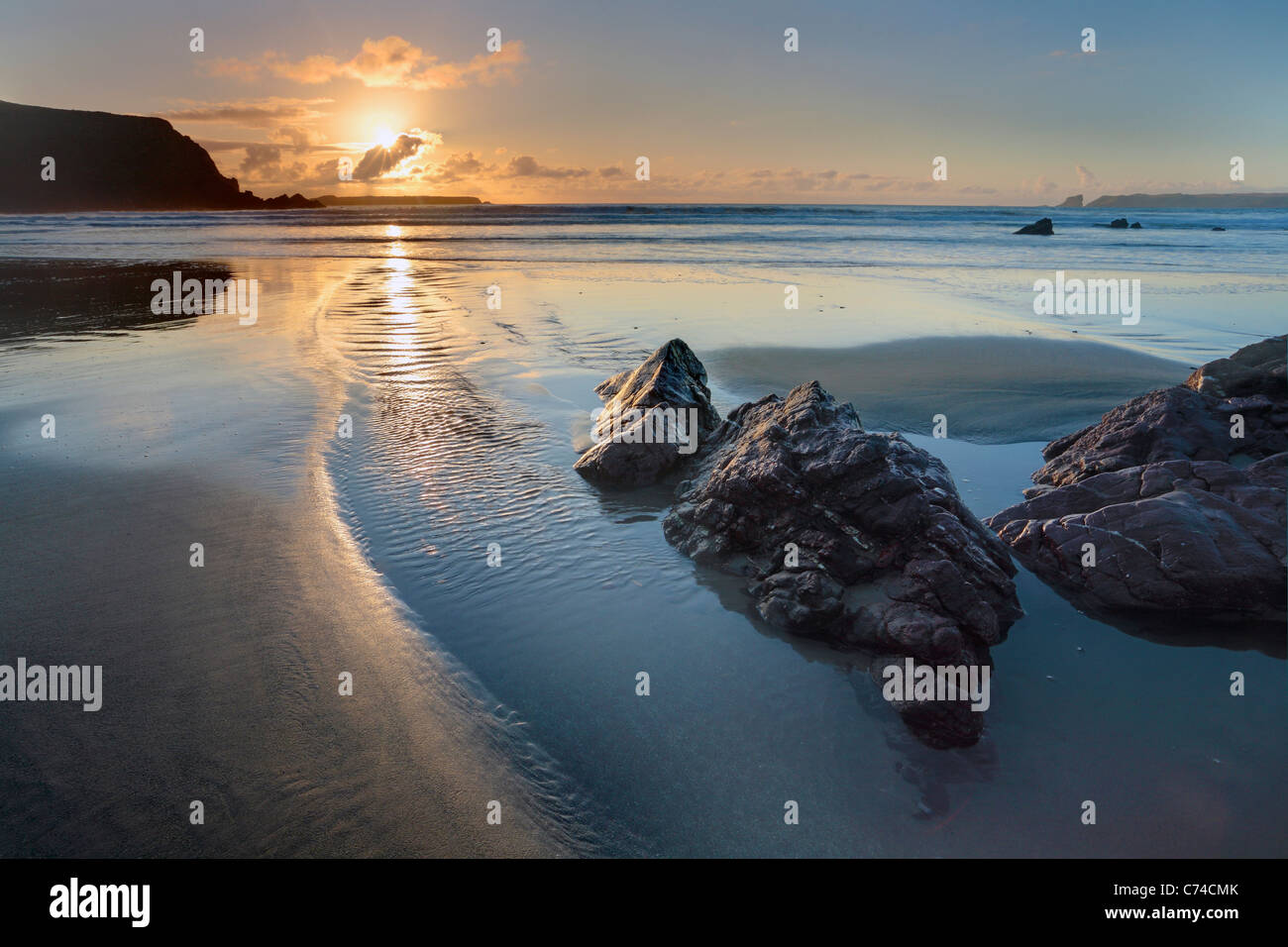 Sunset over Albion Sands in Pembrokeshire, Wales - Stock Image
