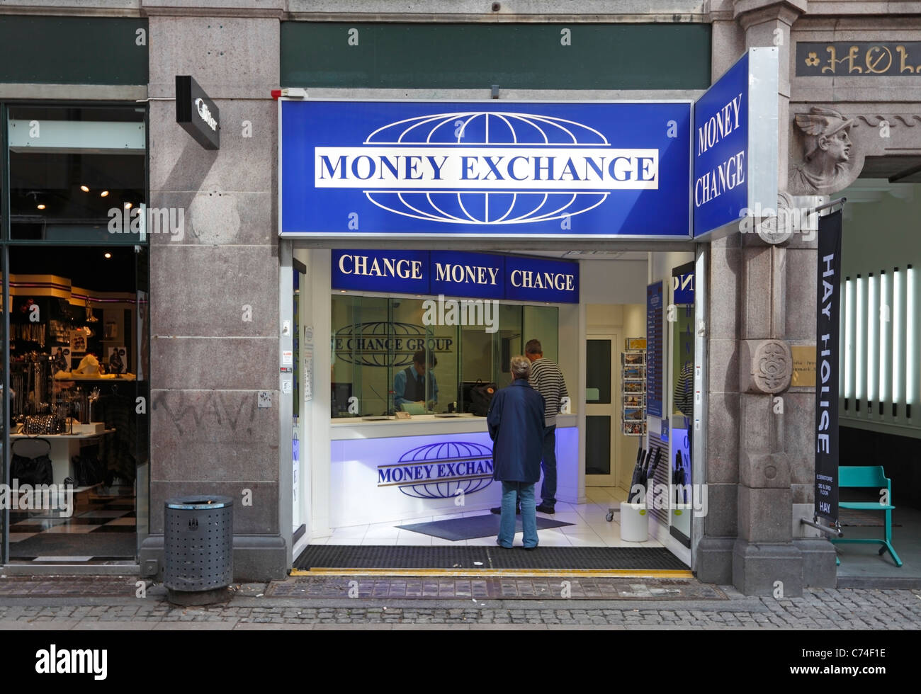 Persons exchanging currency at Money Exchange on the pedestrian and shopping street Stroeget (Strøget) in Copenhagen, - Stock Image