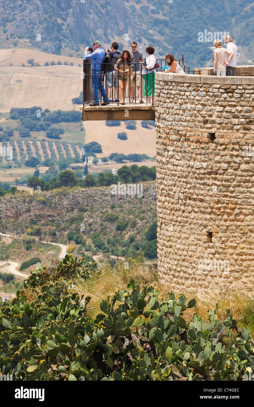 Tourists on lookout point admiring view. Ronda, Malaga Province, Spain. - Stock Image