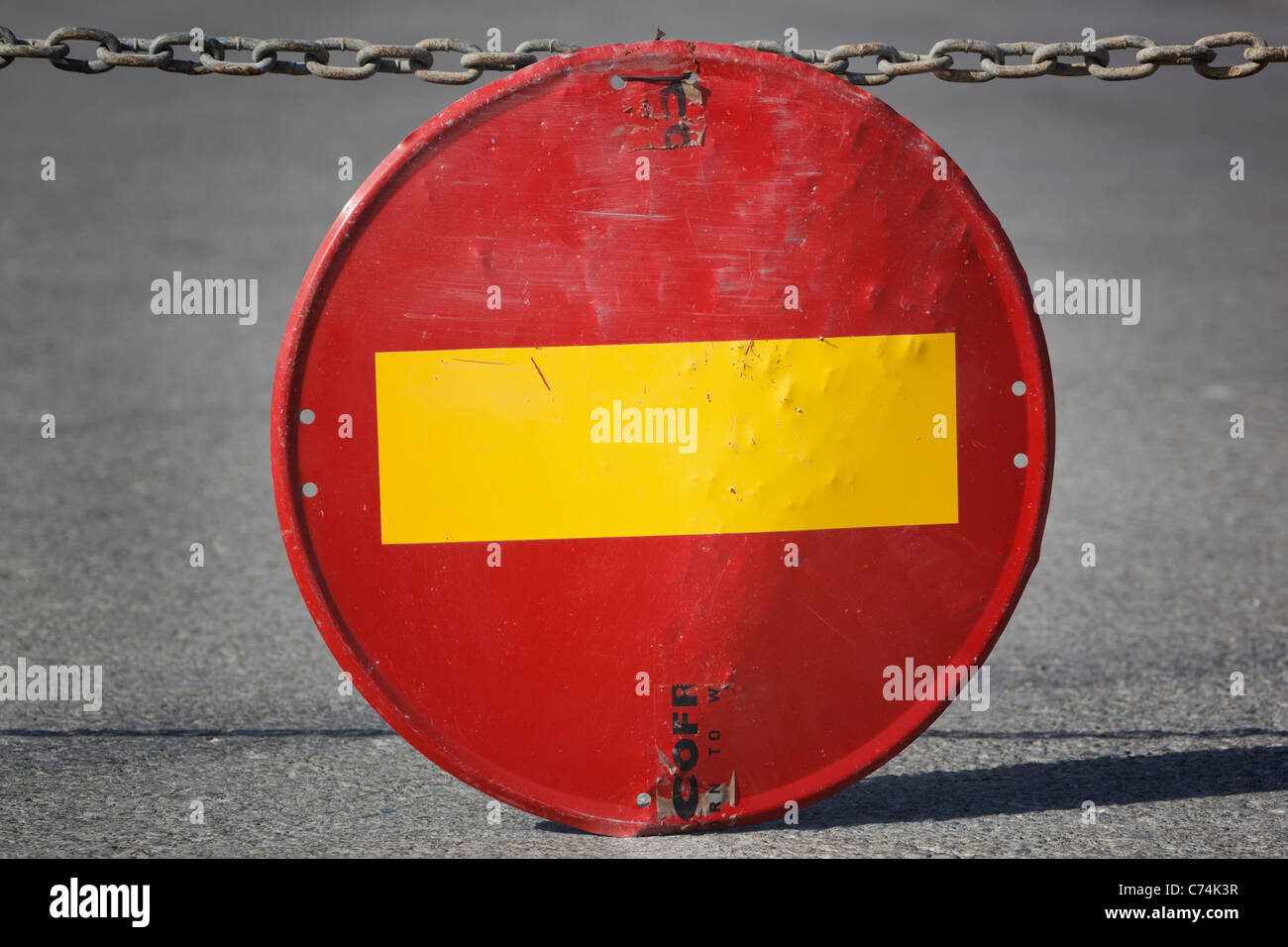 No Entry traffic sign hanging from chain - Stock Image