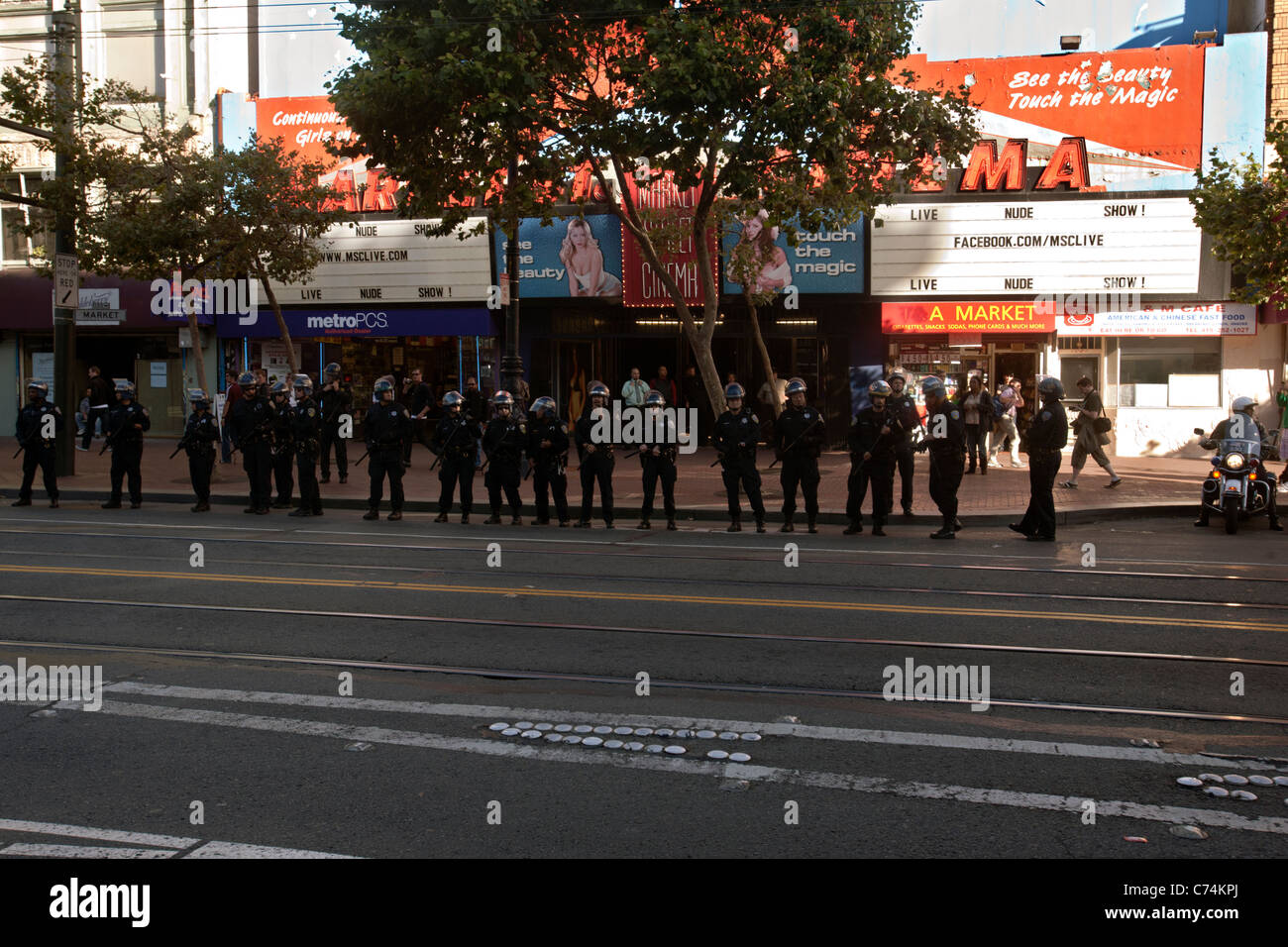riot cops on market street in san francisco - Stock Image
