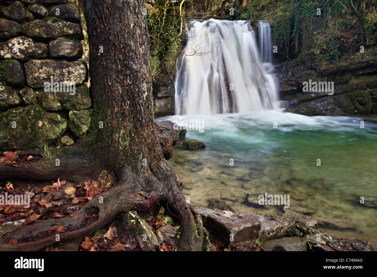 Picturesque waterfall known as 'Janets Foss' in Malhamdale in the Yorkshire Dales of England - Stock Image