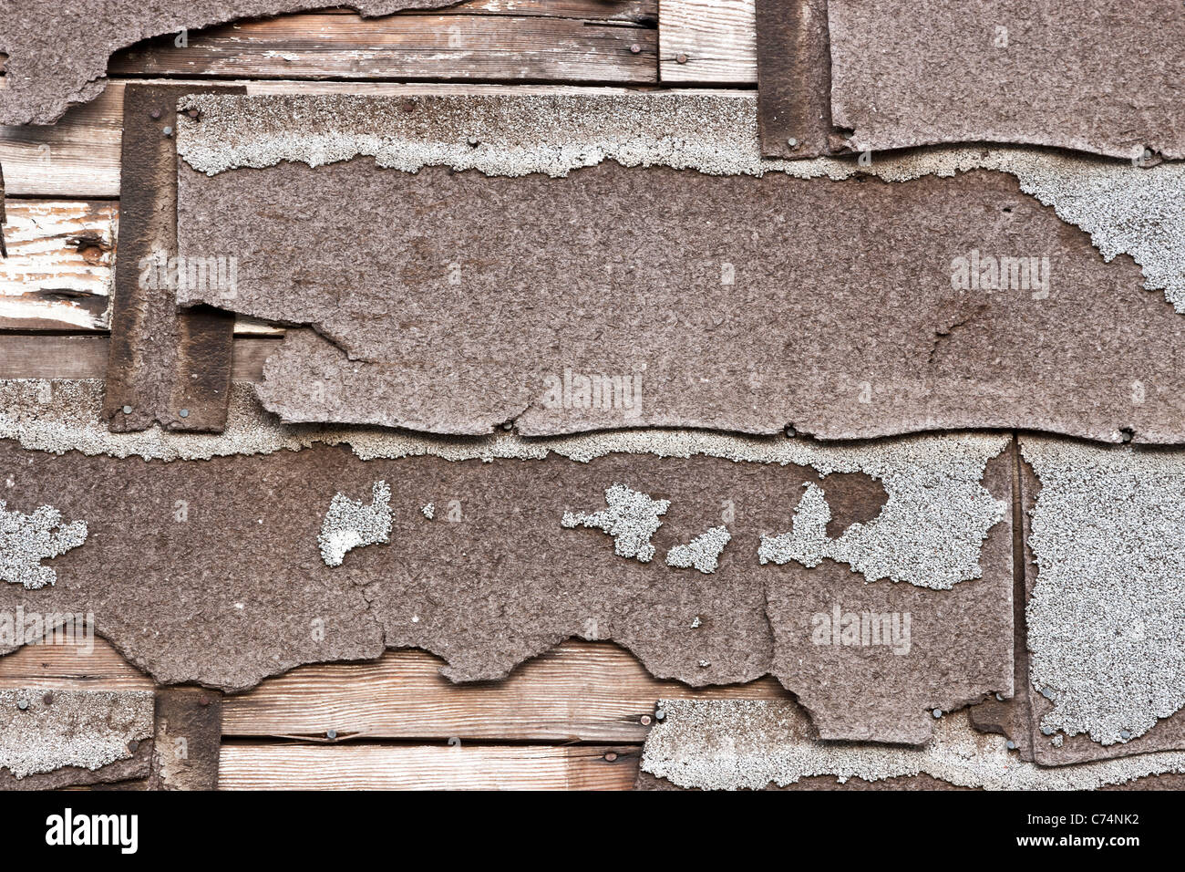 Asbestos composition asphalt shingles deteriorating - Stock Image