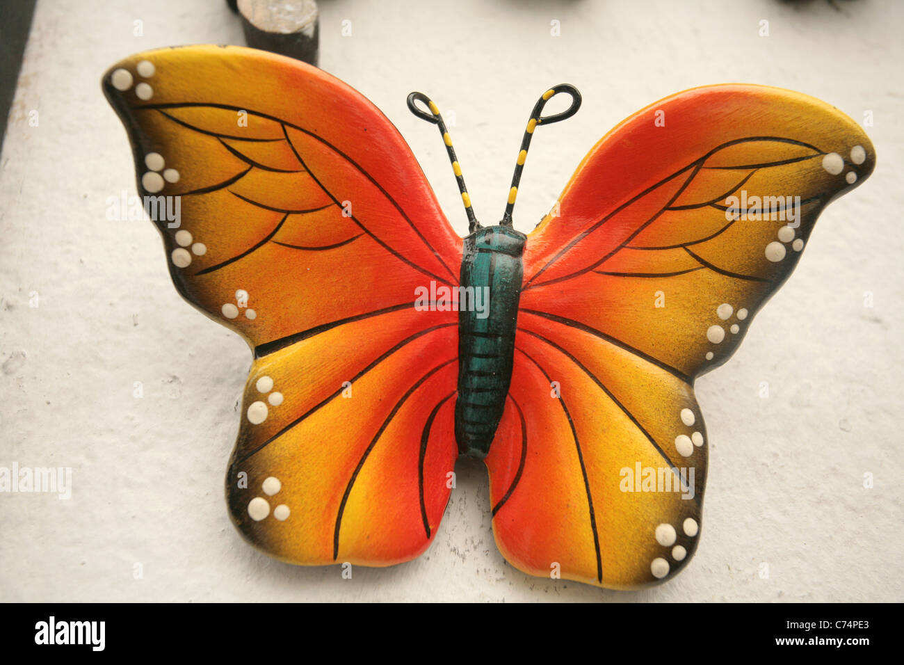 Hand Painted Ceramic Butterfly Craft Decorating The Wall Of A Store