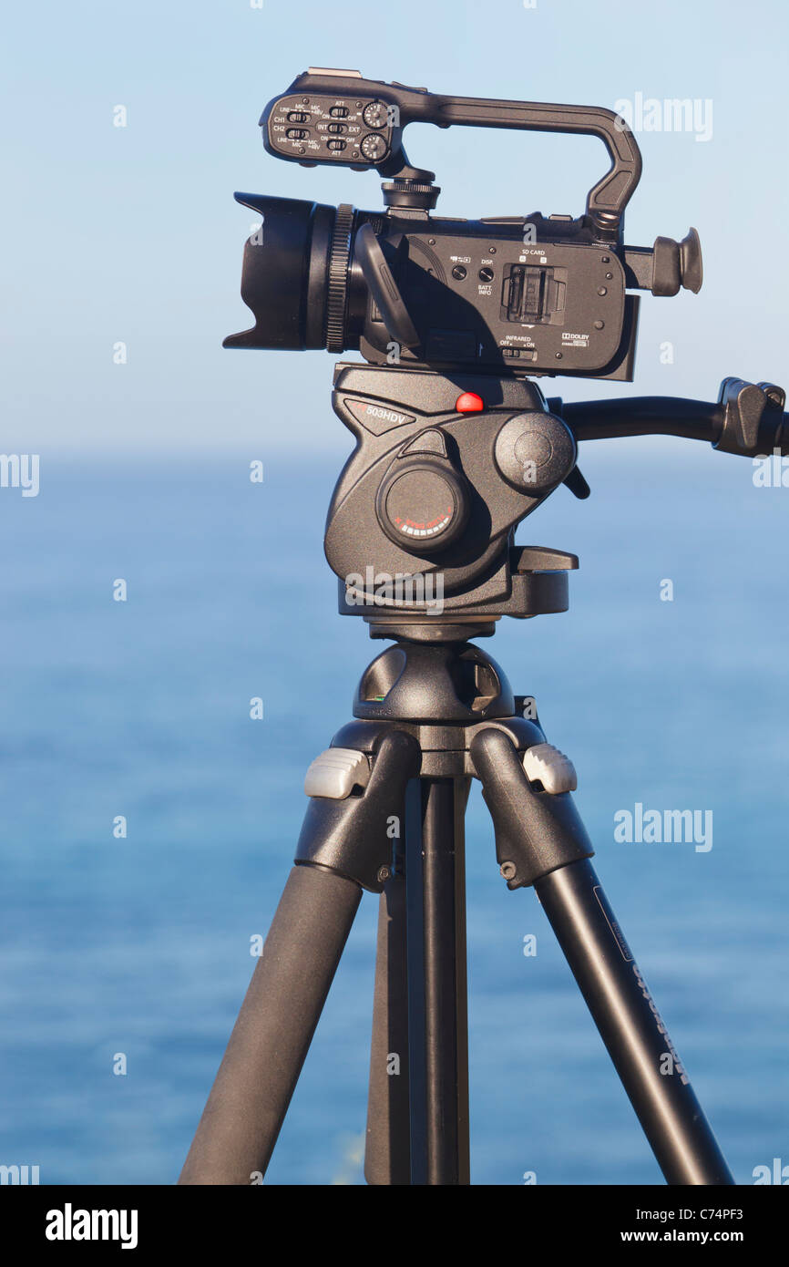 Canon XA10 HD Camcorder mounted on Manfrotto tripod with video head. - Stock Image