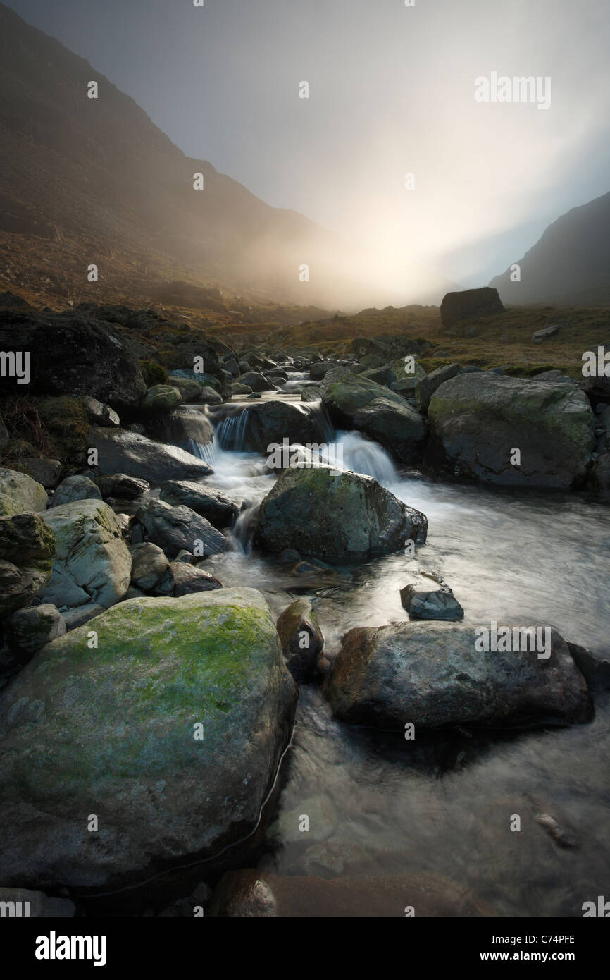 Mist rolls through Honister Pass in the Lake District of England - Stock Image