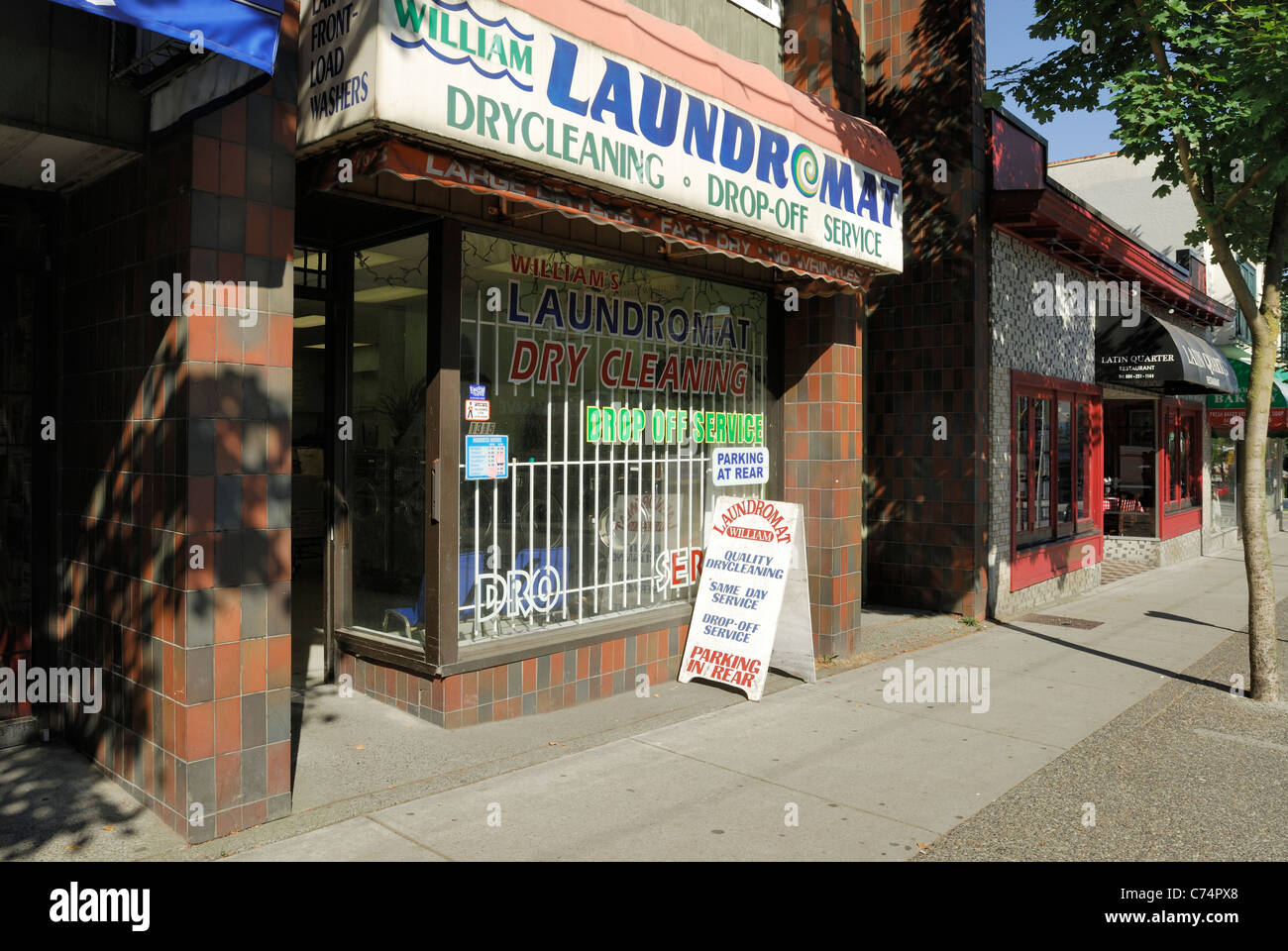 Public laundromat located on Commercial Drive, in the City of Vancouver - Stock Image