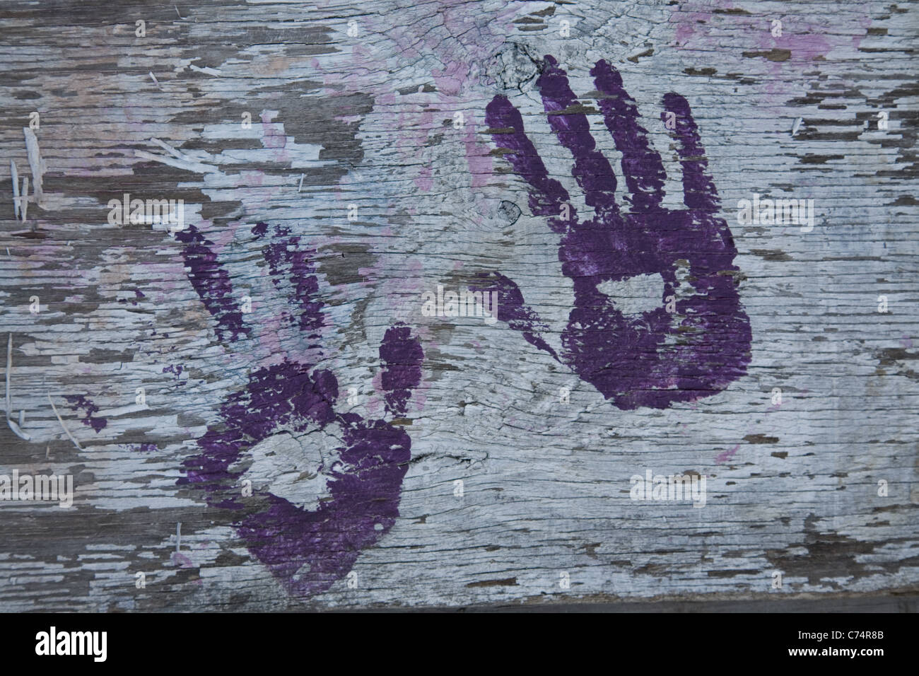 Hand pints found on a plywood wall at a construction site in Brooklyn, New York - Stock Image