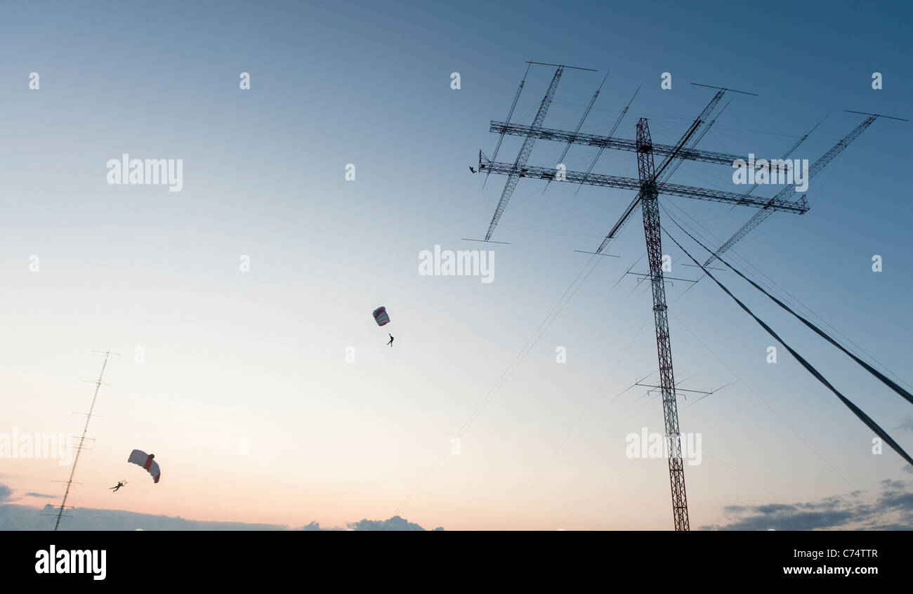 Base jumper taking off from a radio amateur antenna in Oulu, FInland. - Stock Image