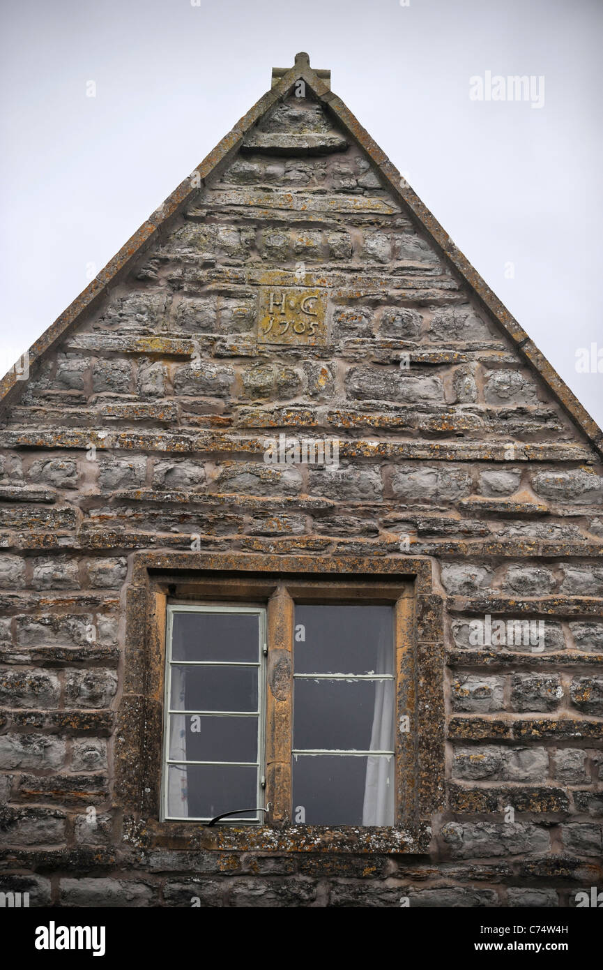 Gable of a house in the village of Pebworth in Worcestershire showing the construction date of 1705 UK - Stock Image