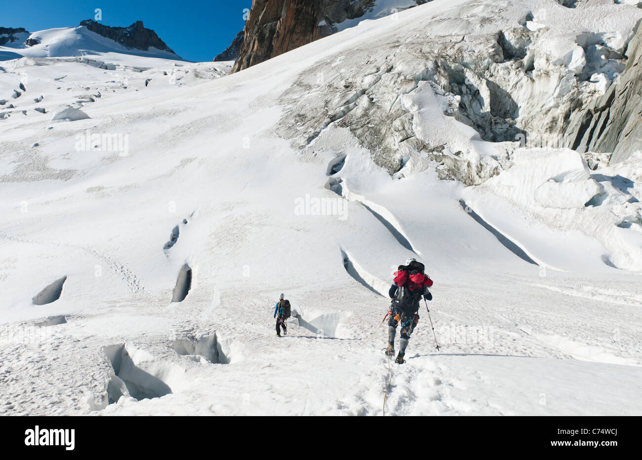 Climbers walking among crevasses on the Vallee Blanche glacier in Chamonix, France Stock Photo