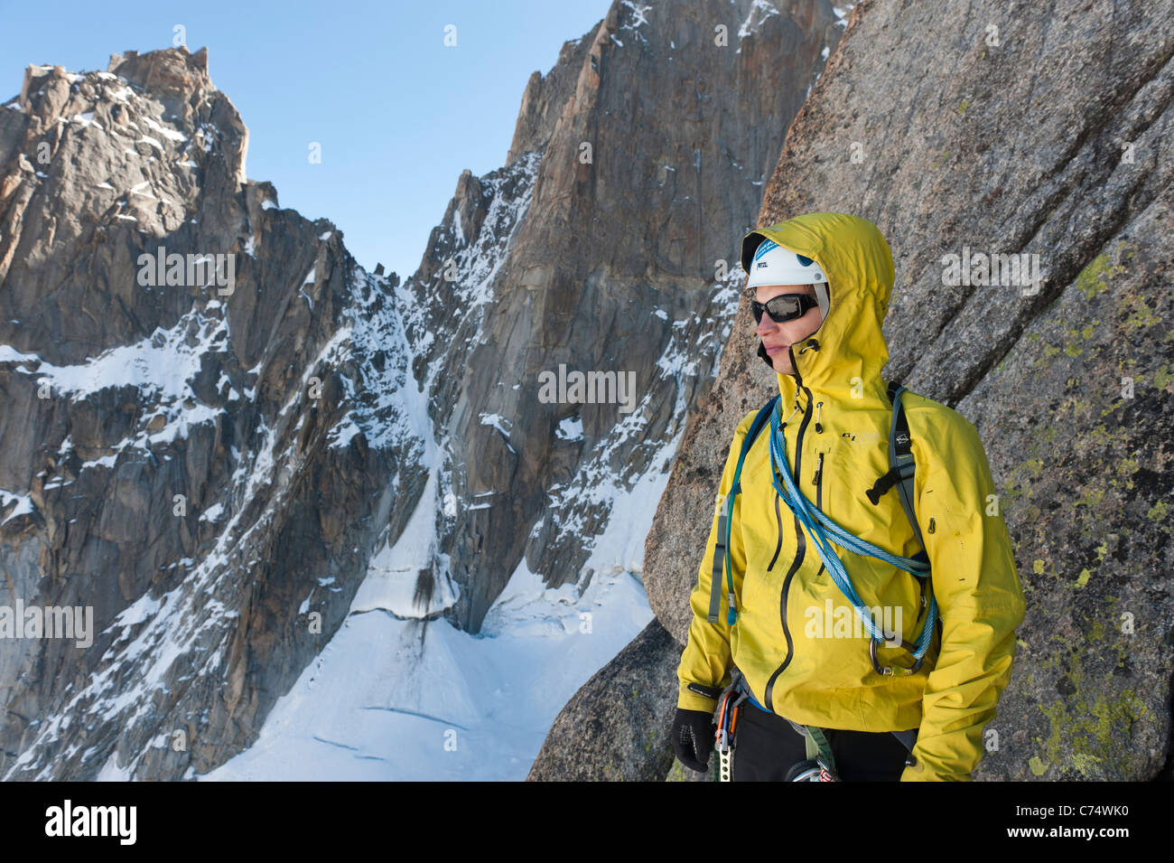 A rock climber abseiling down Pyramide du Tacul in Chamonix, France Stock Photo