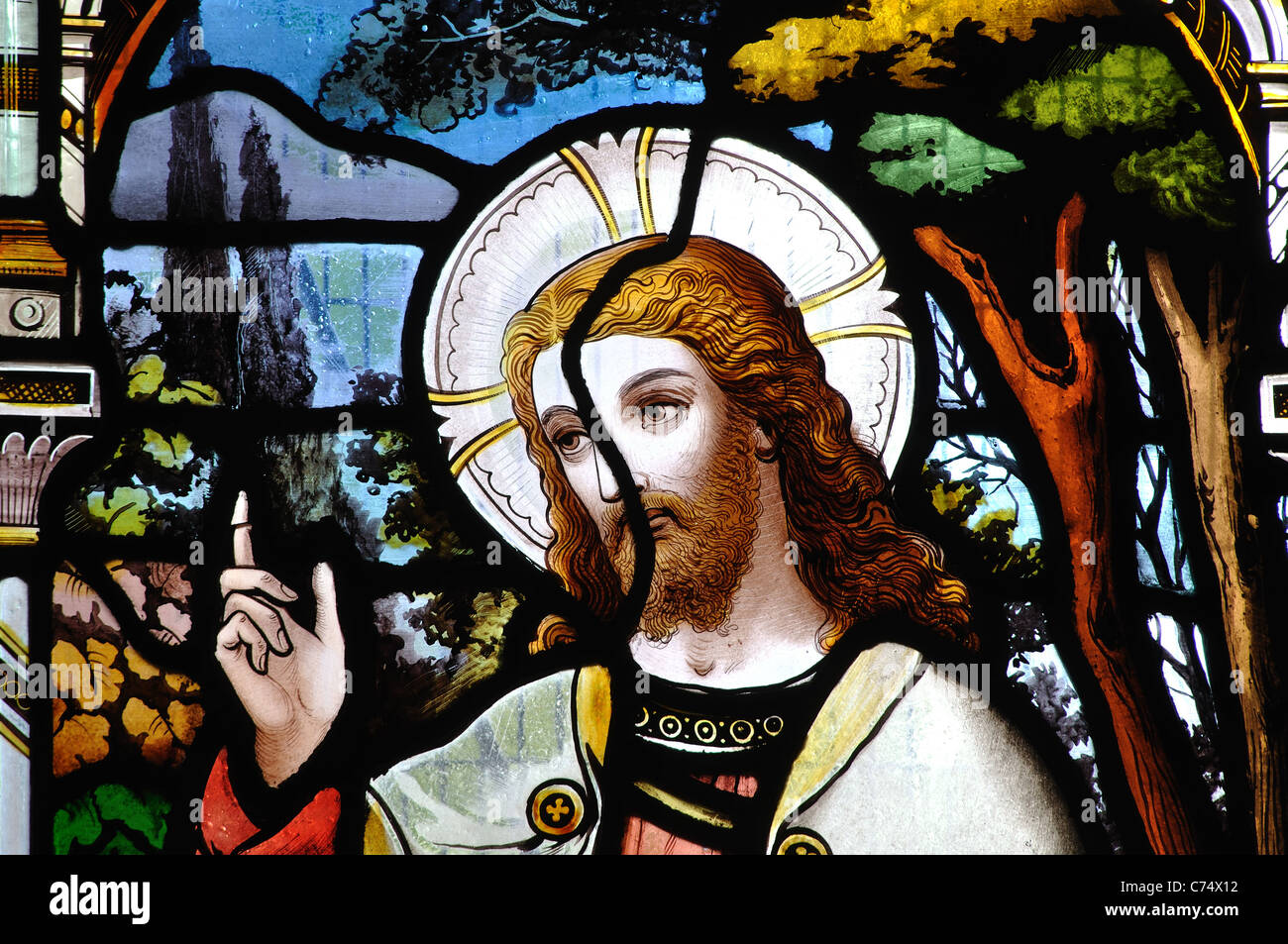 Repaired stained glass, St. Helen`s Church, Sharnford, Leicestershire, England, UK - Stock Image