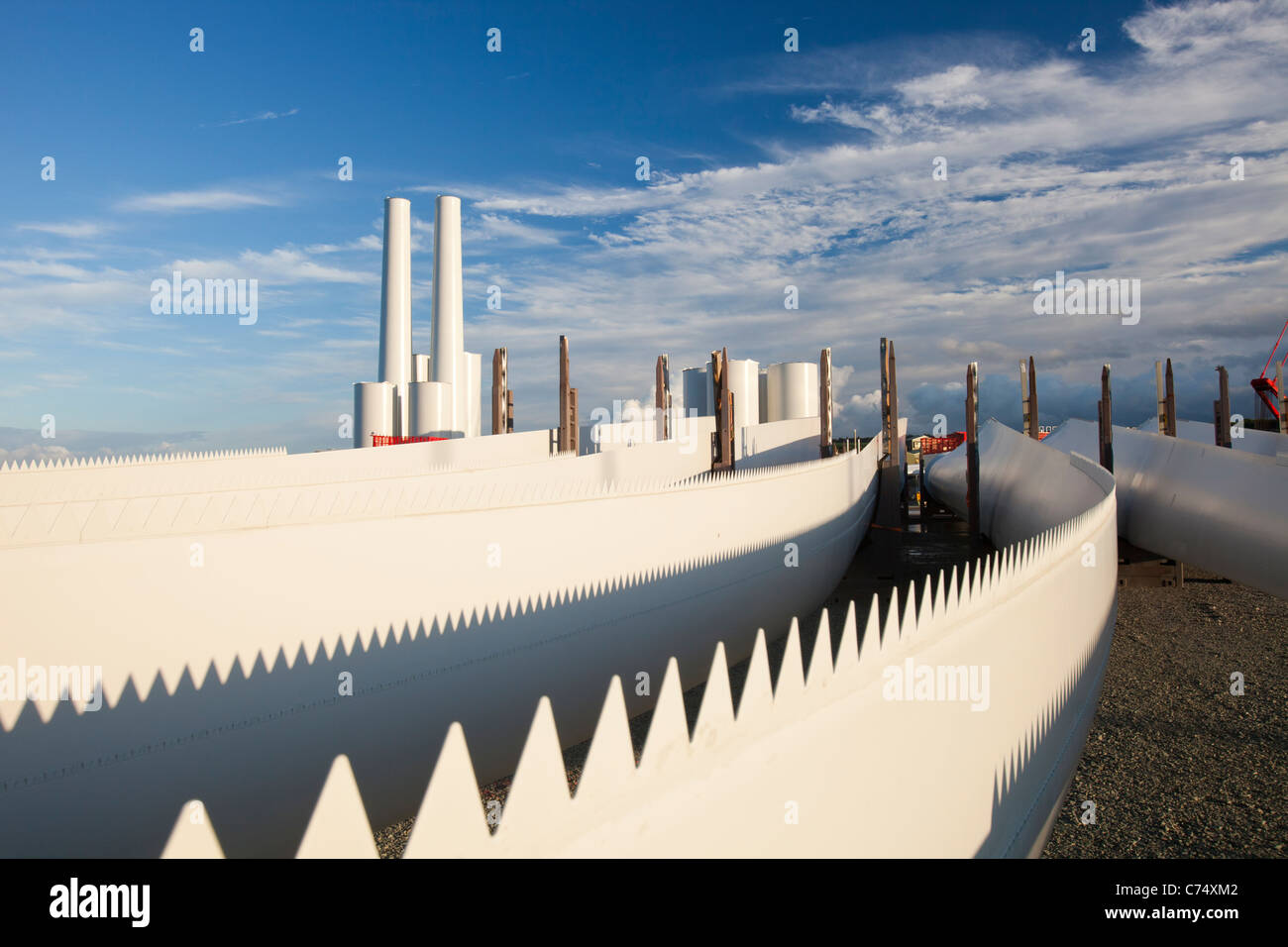 wind turbine blades with serrated teeth to increase efficiency on the docks at Mostyn, bound for the Walney offshore - Stock Image