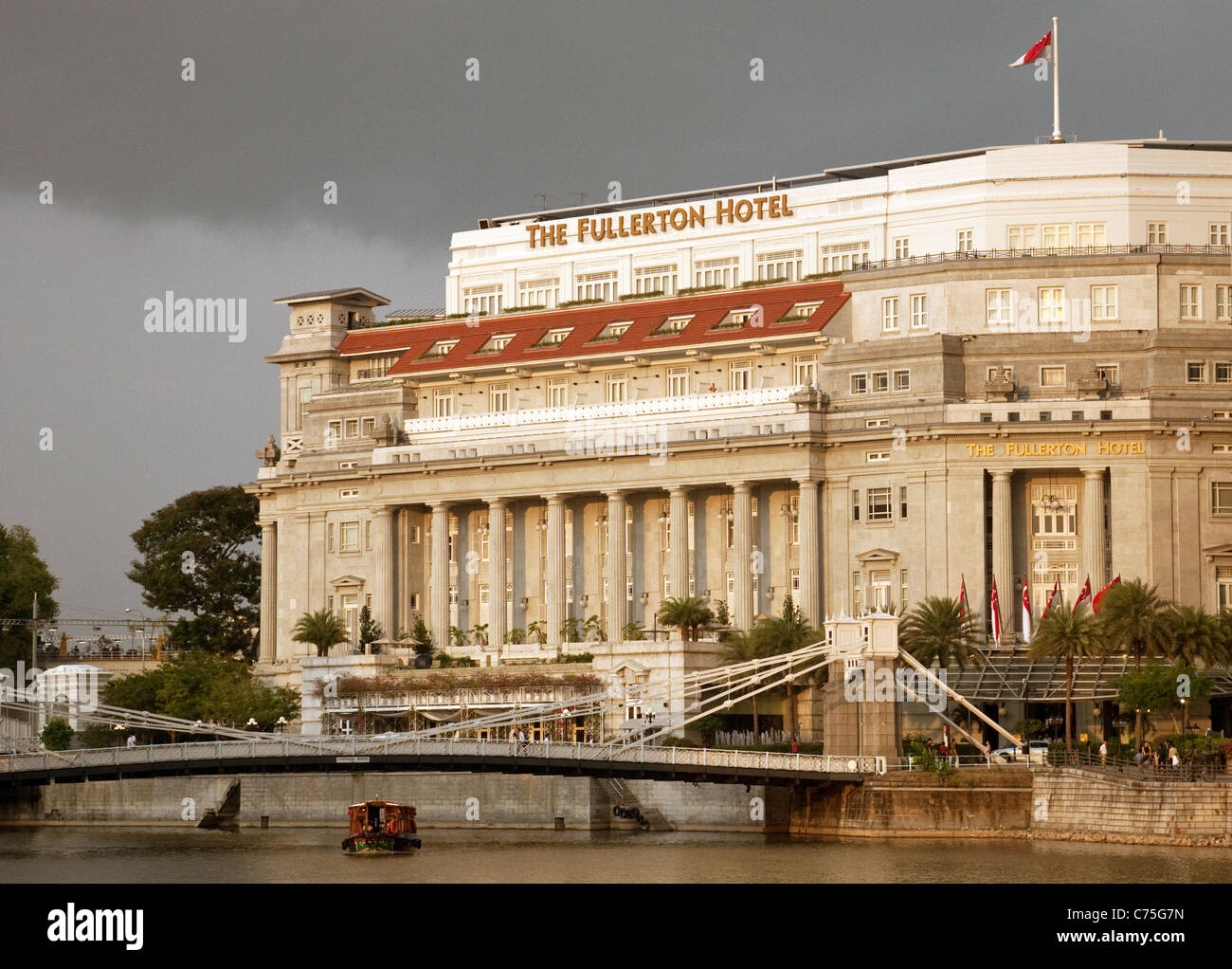 Evening view of the Singapore River and Fullerton Hotel, Singapore Asia - Stock Image