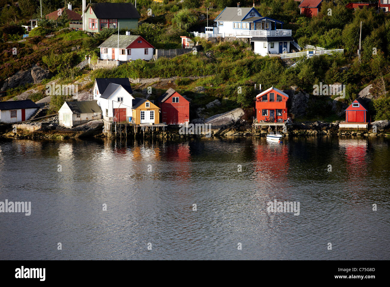 Traditional Norwegian timber-clad properties on the fjord side, Bergen, Norway. - Stock Image