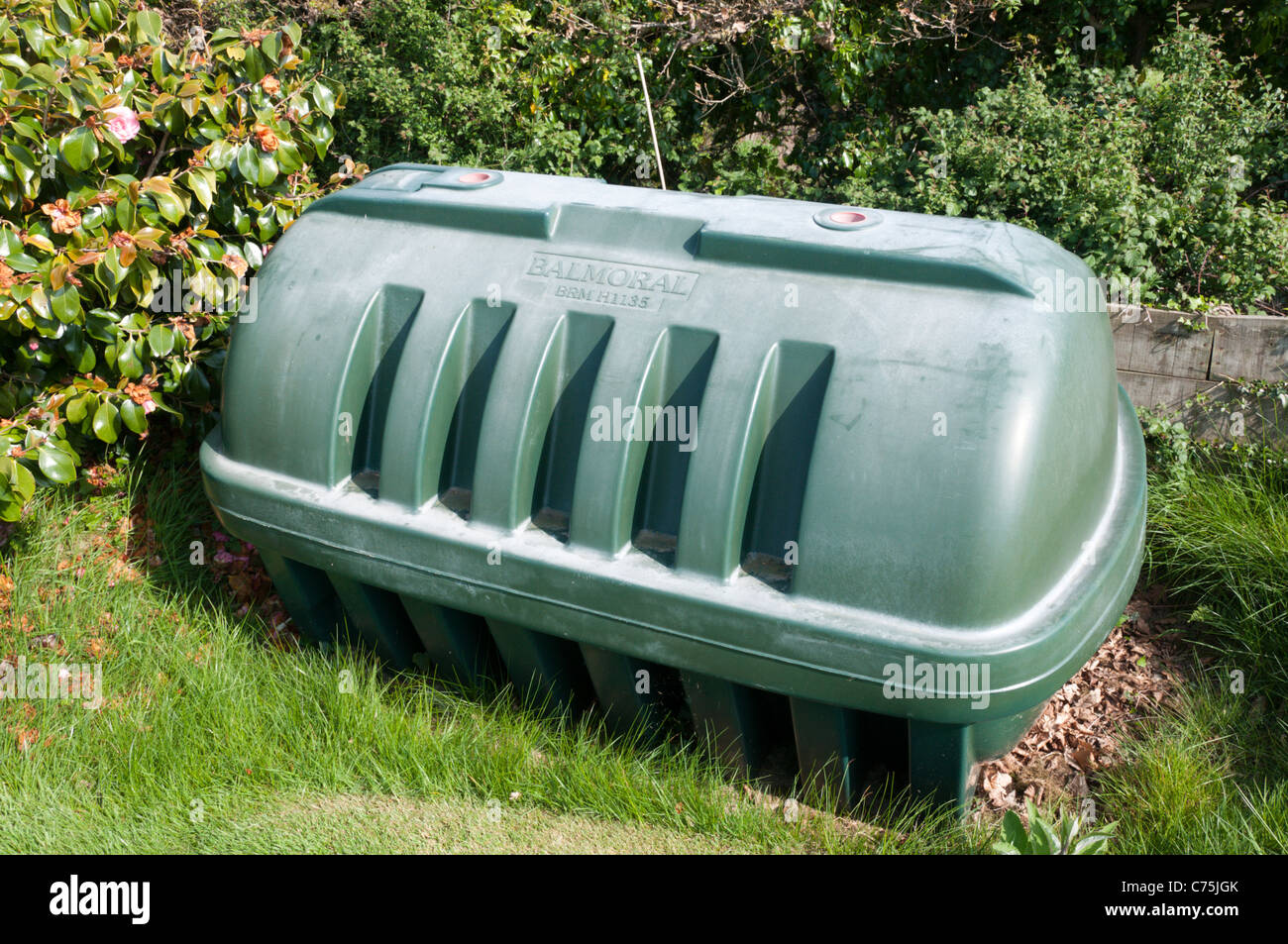 A central heating oil tank in a domestic garden Stock Photo ...