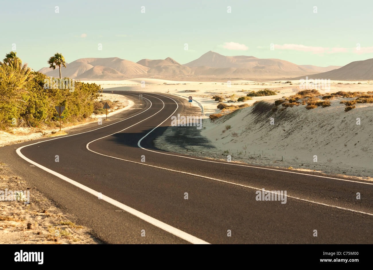 Winding Desert Road across the dunes of Corralejo, Fuerteventura Stock Photo