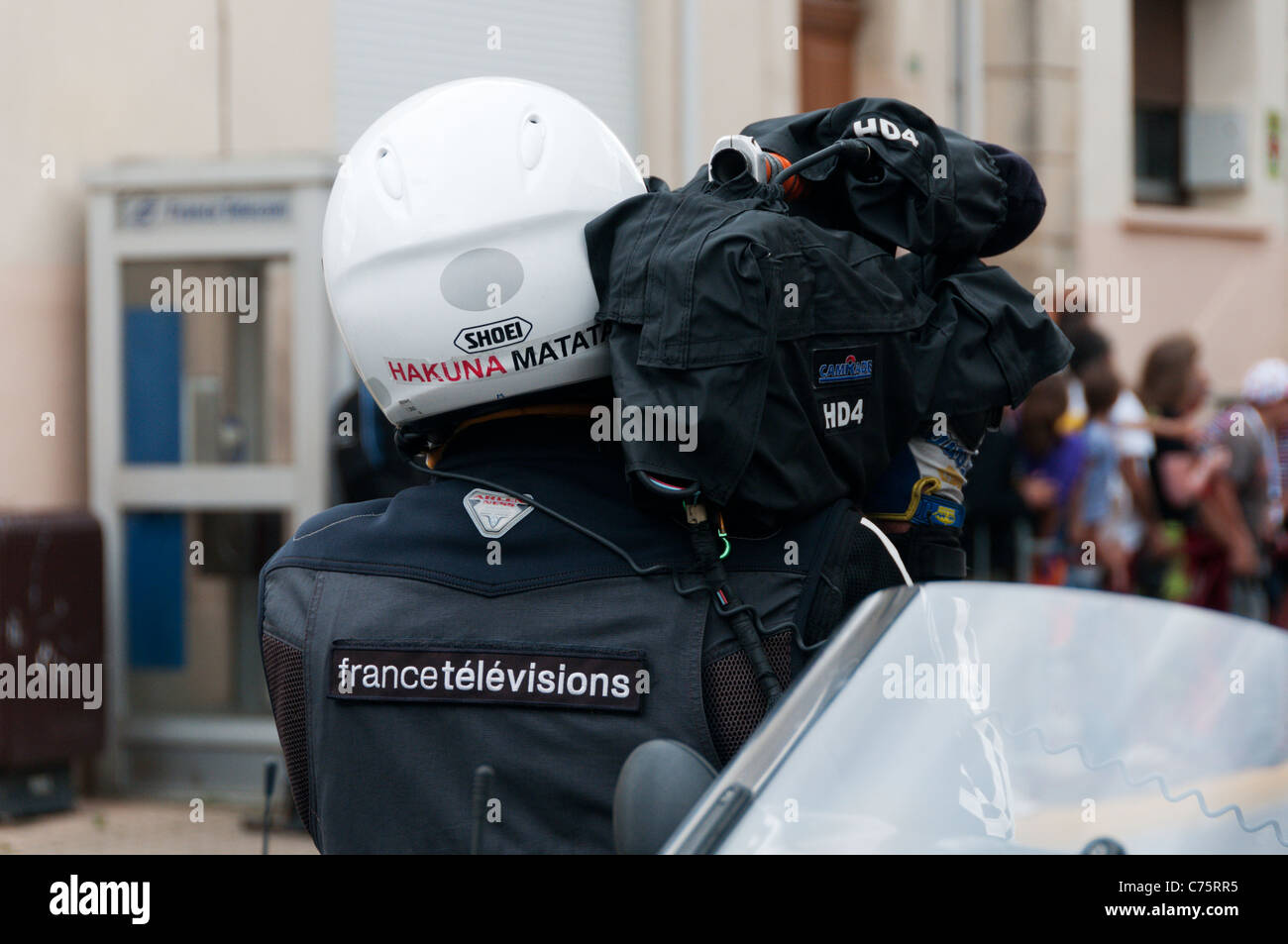An outside broadcast cameraman for France Televisions filming the Tour de France. Stock Photo