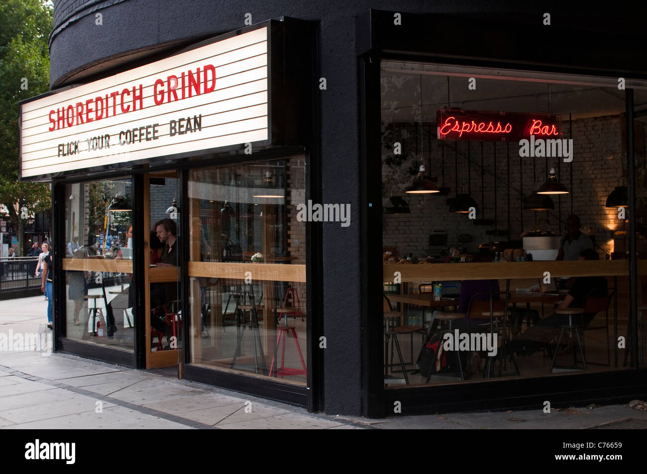 The exterior of the Shoreditch Grind espresso bar, a new cafe in East London on Old Street roundabout, London. - Stock Image