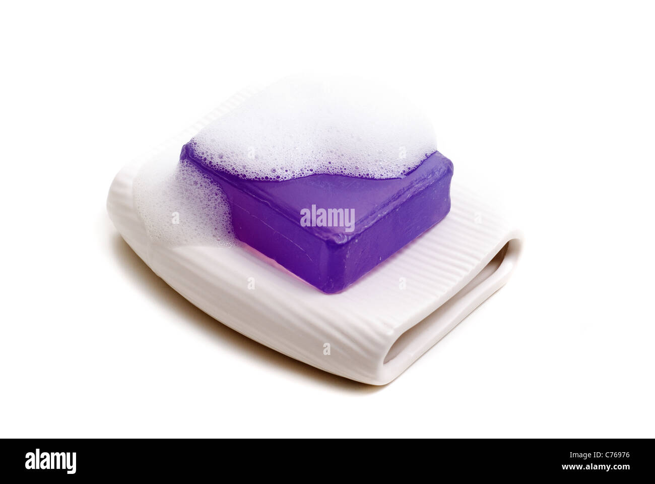 Bar of soap with soap bubbles. - Stock Image