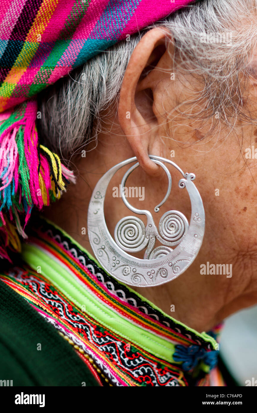 The typical earrings of Hmong women in the Sapa region, North of Vietnam. - Stock Image
