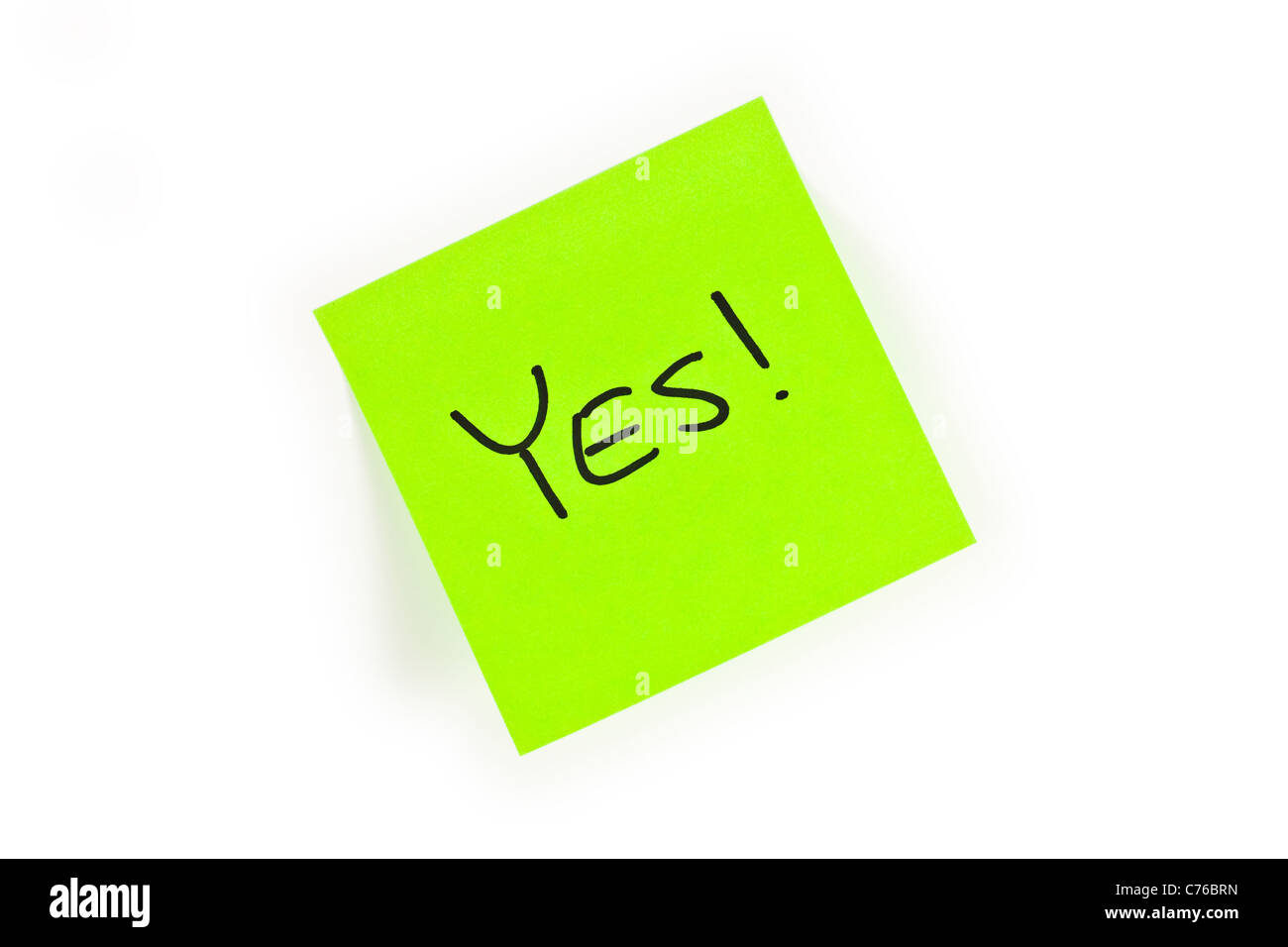 Post-it with the word YES! written on it isolated on white - Stock Image