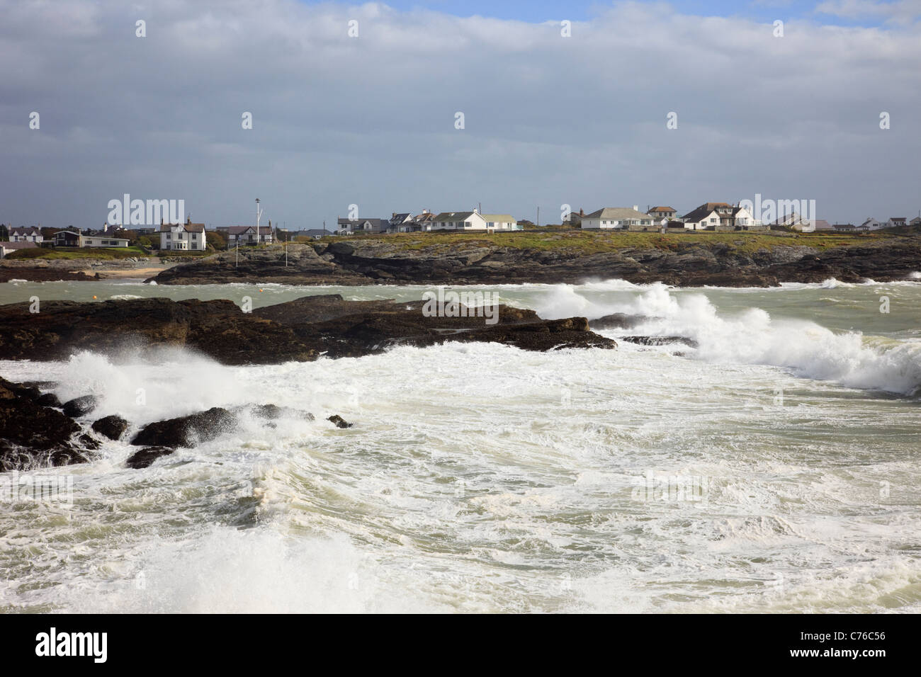 Trearddur Bay, Anglesey, North Wales, UK. View across rough stormy sea with waves crashing on rocks on exposed west - Stock Image