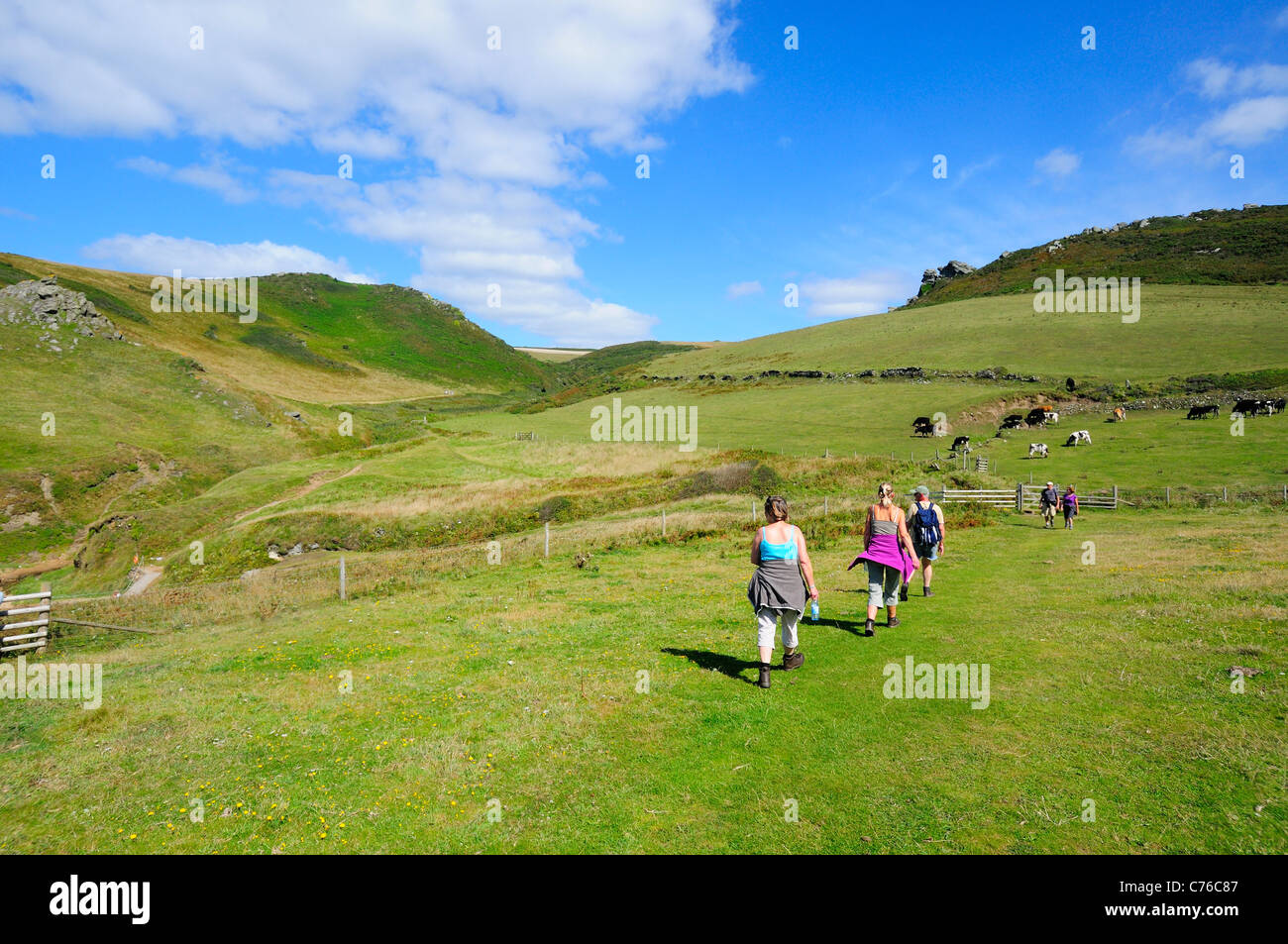 Ramblers  on the southwest coastal path at Soar Cove near Salcombe - Stock Image