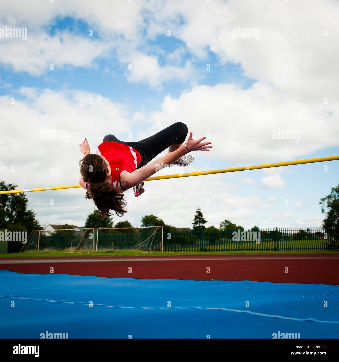 Sian Swanson, teenage high jump athlete training outdoors at her local leisure centre, Newtown Powys Wales UK - Stock Image