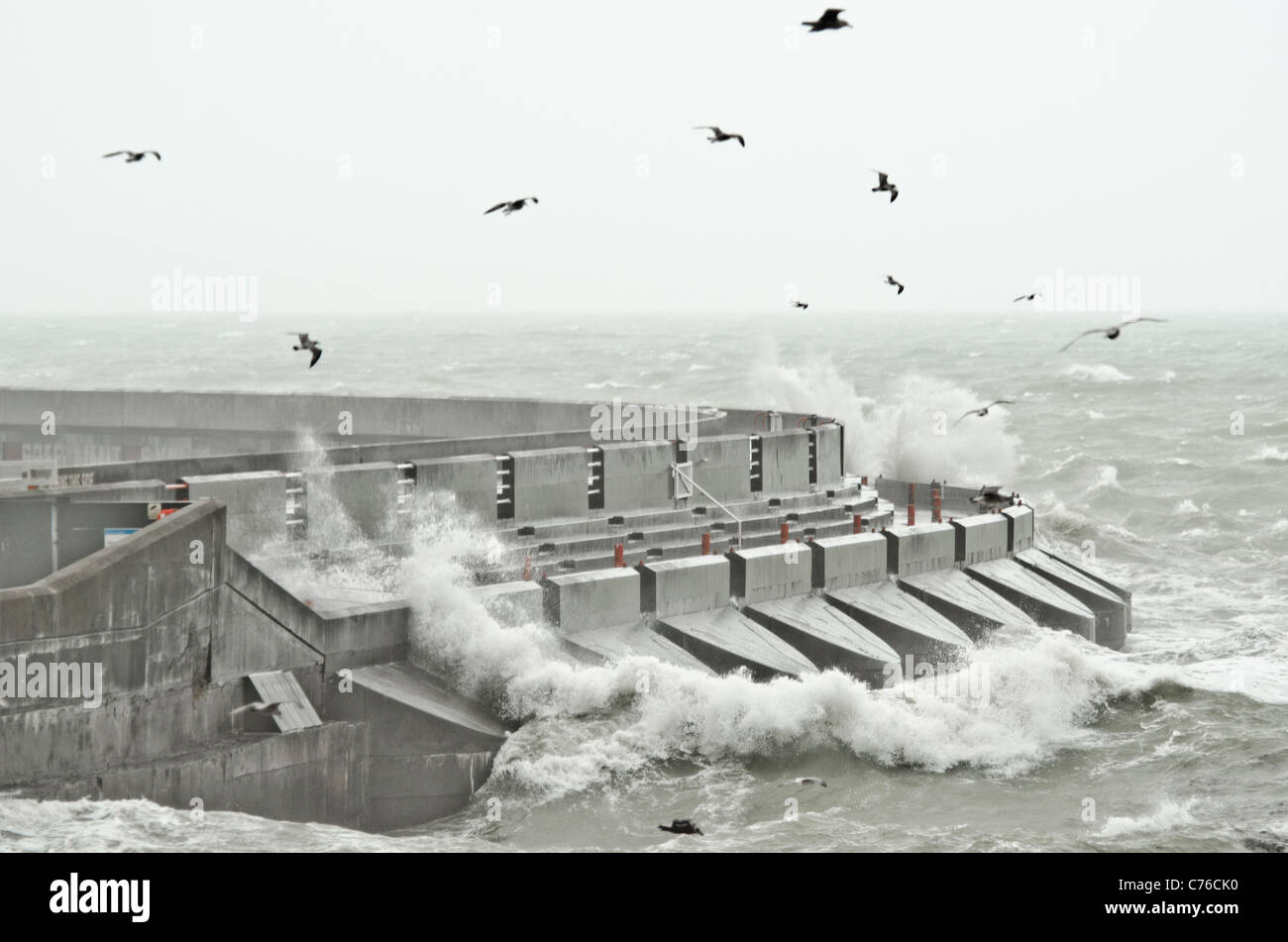 Gale force winds bring huge waves to the Brighton Marina, East Sussex. - Stock Image