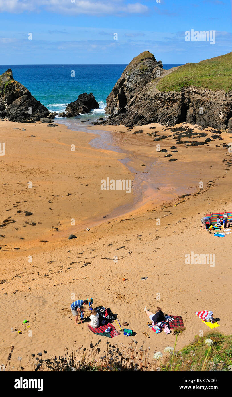 Families picnicking on  the secluded sandy cove beach at Soar Cove  near Salcombe on the southwest coastal path - Stock Image