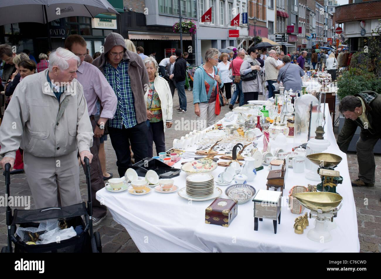 Sunday antiques market on street in Tongeren in Belgium - Stock Image