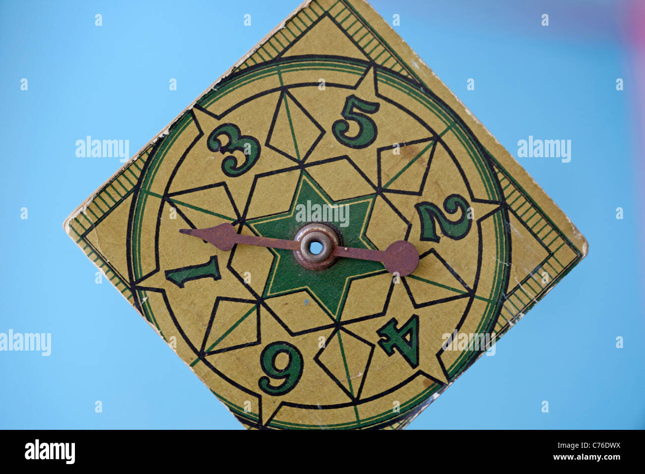 antique game spinner - Stock Image